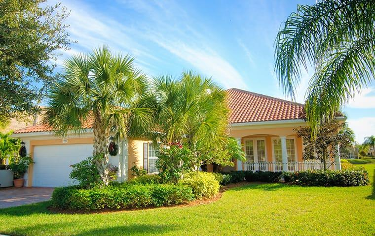 a view of the lawn and landscaping of a home in boca raton florida