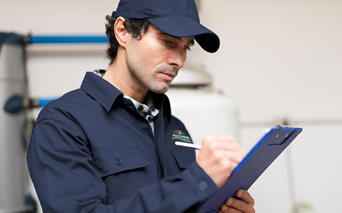 technician looking at a clipboard
