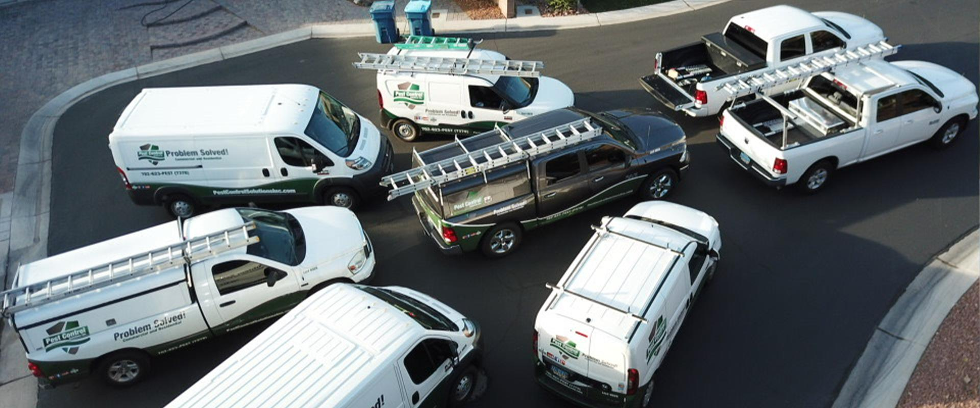 overhead view of pest control solutions vehicles