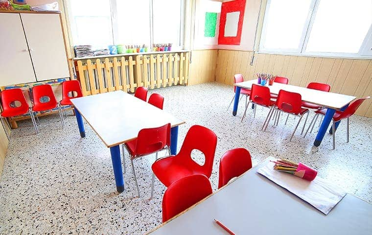 a school classroom with red chairs around a few tables in rocklin california