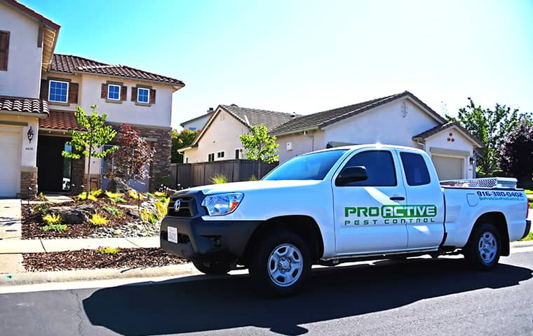 a white pro active service truck in front of a rocklin home