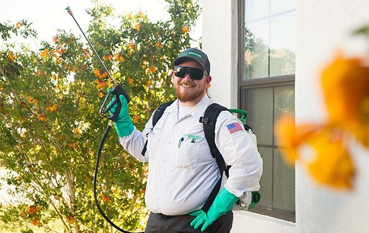 professional pest control tech posing