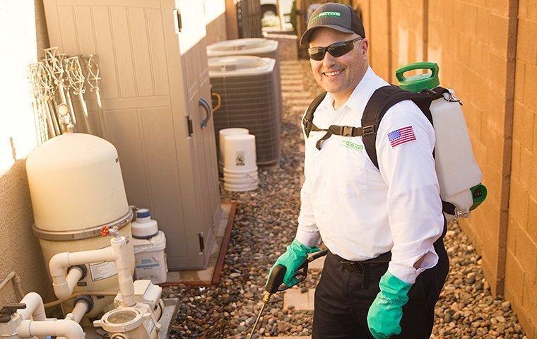 service tech treating backyard