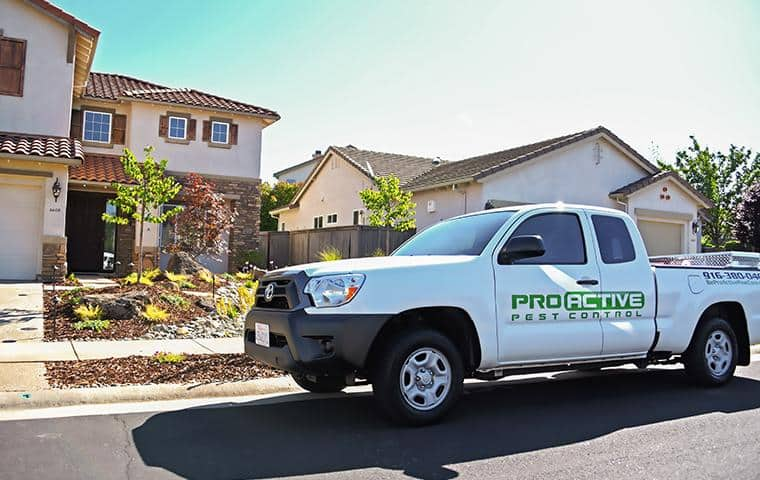 a white service truck outside of a home in elk grove california