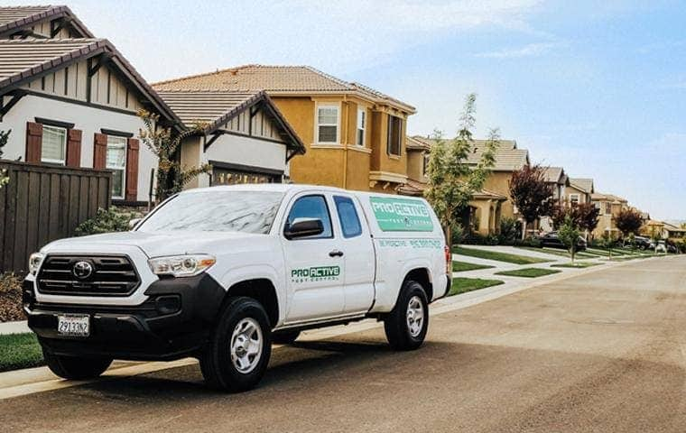 a pro active pest control company service truck traveling though roseville california