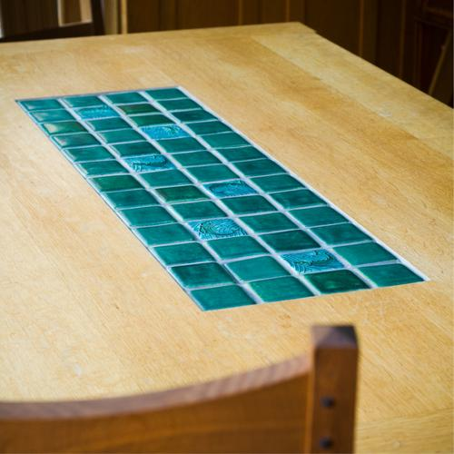 Dining table with Motawi Tile center insert.