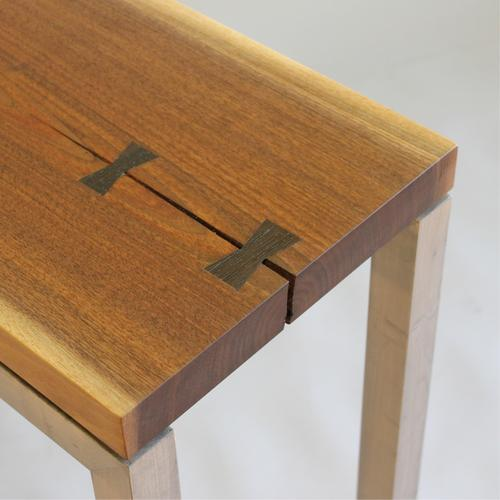 contemporary display table in Walnut.