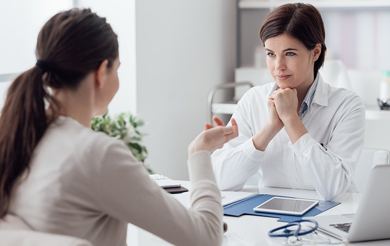a friendly doctor talking with her patient