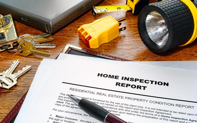 a home inspection report on table