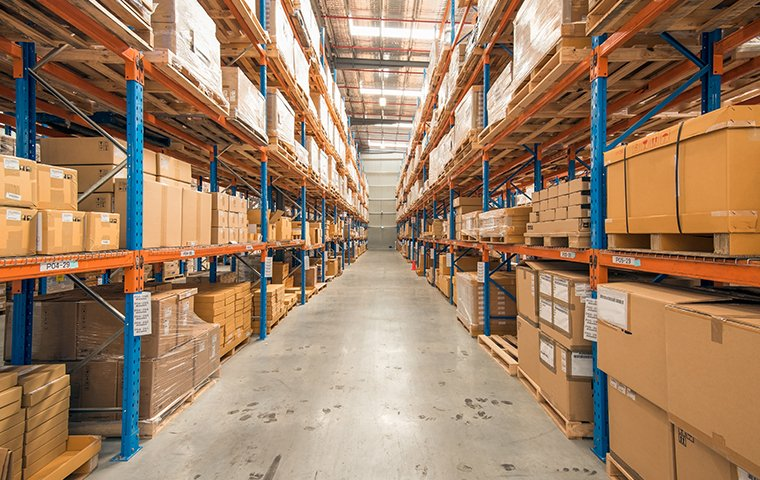 boxes stacked high in a warehouse