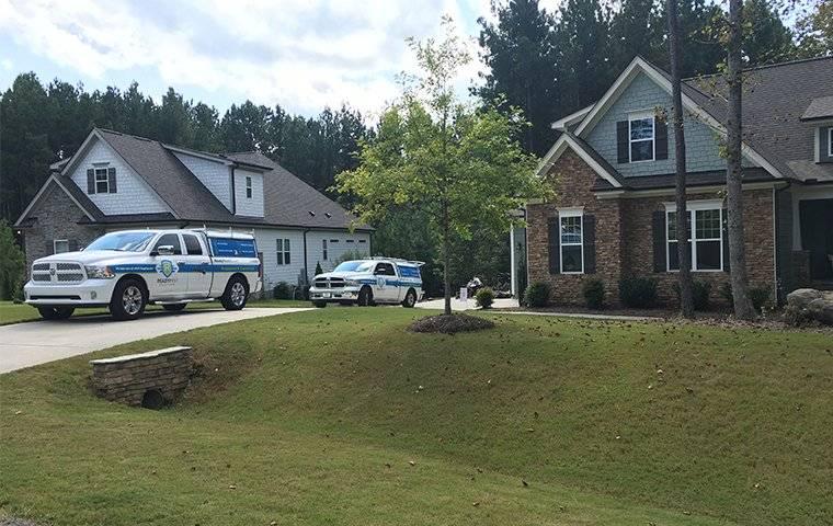 company trucks at a house