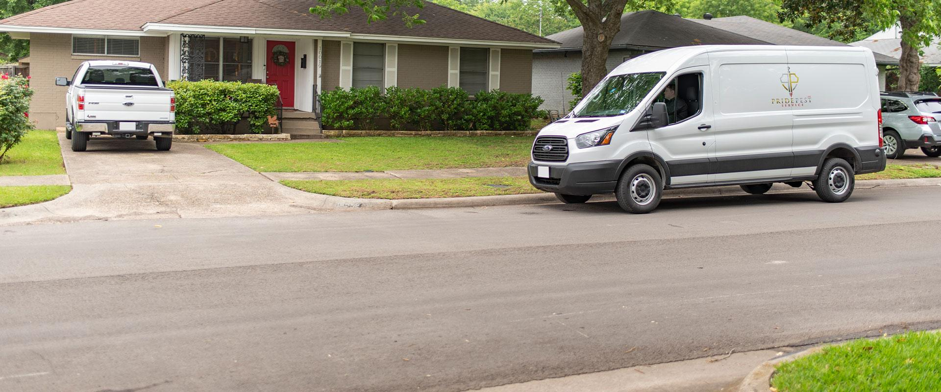 van pulling up to house
