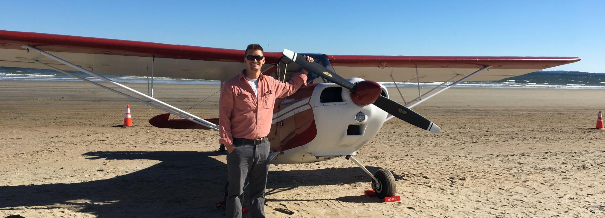 Matt standing with a plane