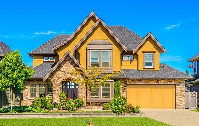 street view of a suburban home in the woodlands texas