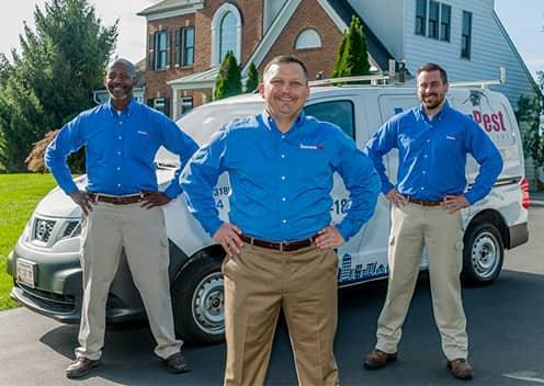 american pest team members in front of vehicle