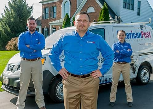american pest team members in front of vehicle