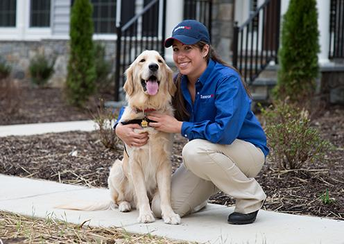 a service technician smiling with a k9 inspection dog in falls church virginia