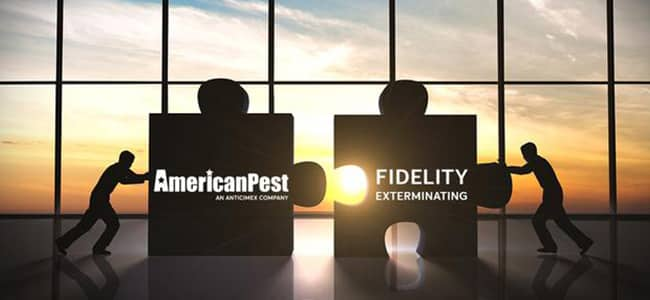 image of two people pushing pieces together representing american pest acquiring fidelity exterminating