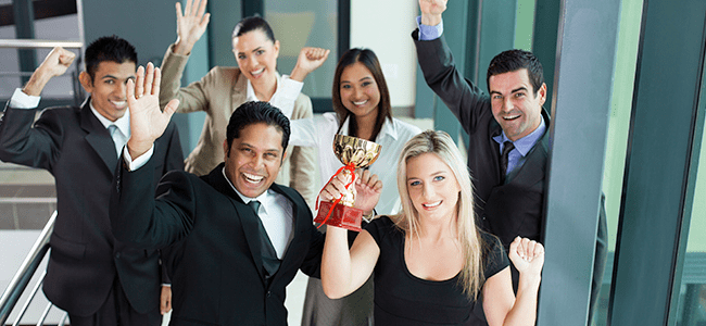 employees raising a trophy