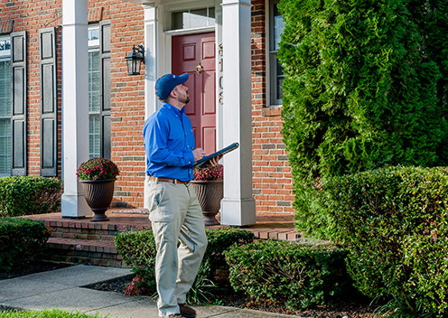 a pest control technician inspecting a home in severn maryland