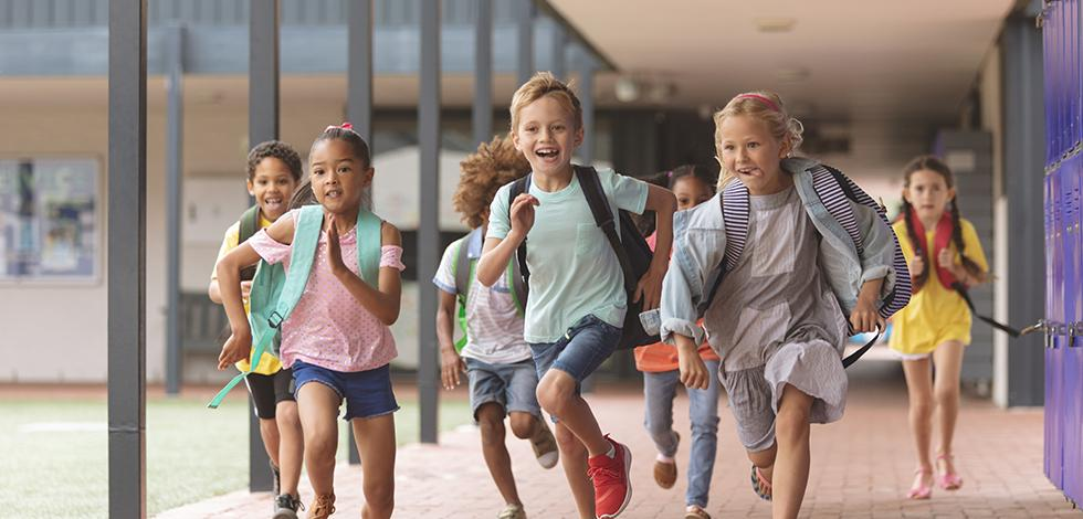 children running with backpacks at maryland school