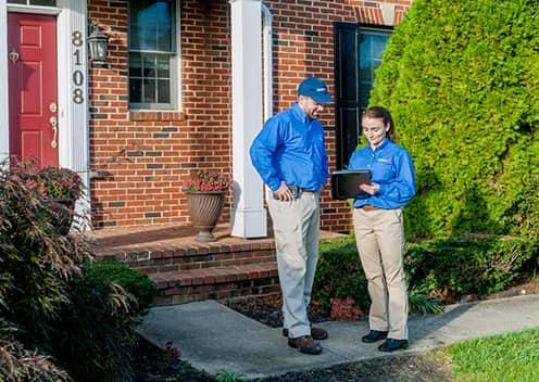 american pest technicians discussing an inspection in chantilly virginia
