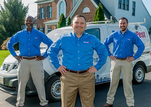 three service technicians in front of a home in daniels maryland