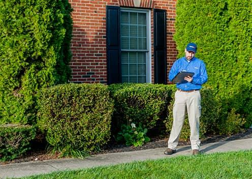 a service technician performing an exterior inspection in elkridge maryland
