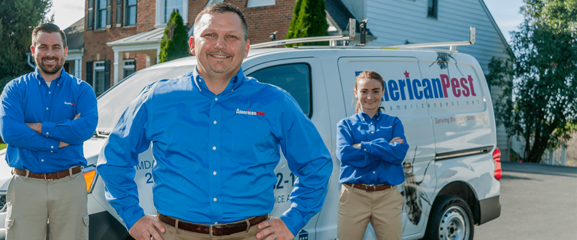 service technicians in from of an american pest vehicle