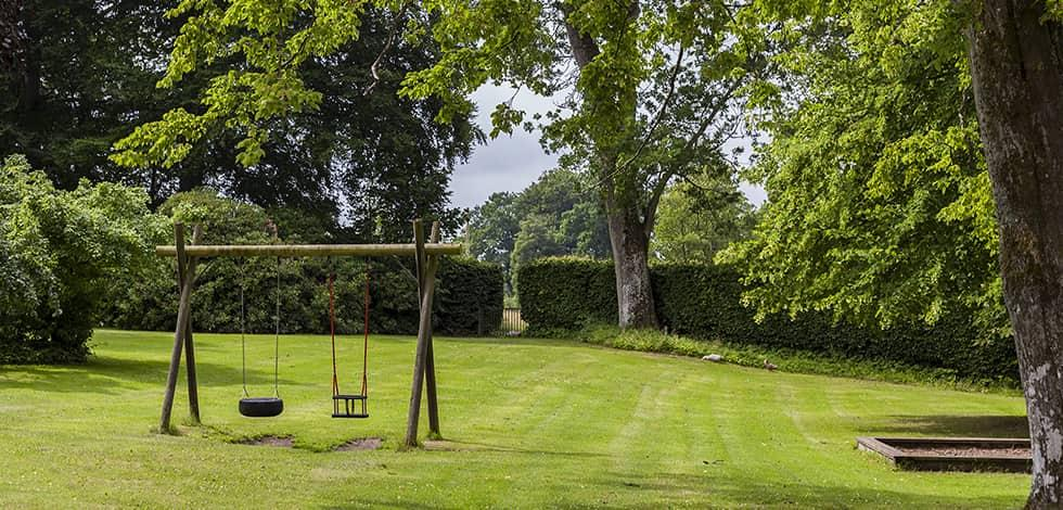 a well kept lawn with a swing set in brookeville maryland