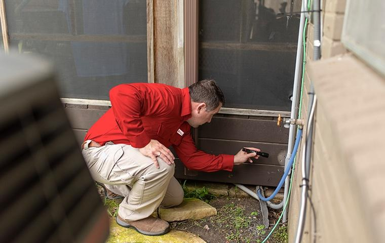 a pest control service technician inspecting the interior of a home for pests in rancho cucamonga california
