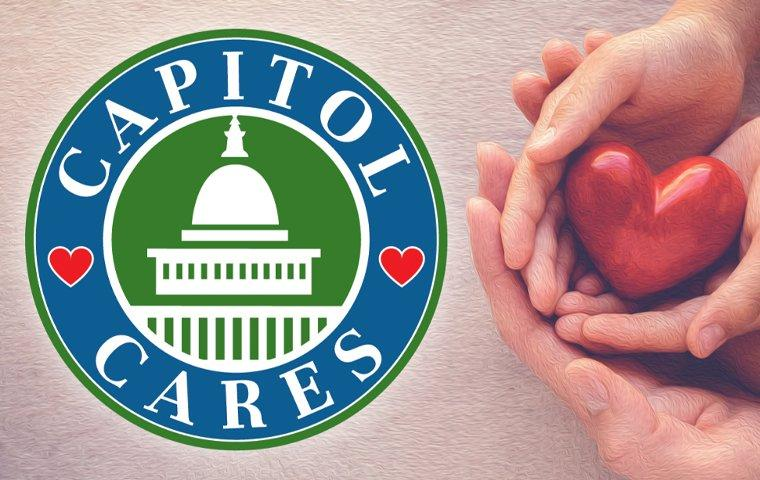capitol cares logo and hands holding a heart