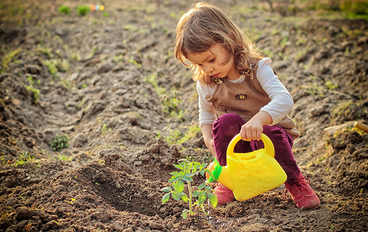 little girl playing in the dirt