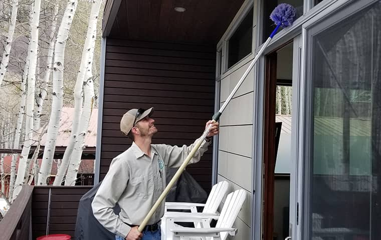 a ram wildlife and pest management service technician treating a home in de beque colorado