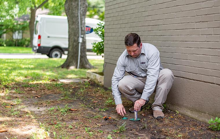 dallas termite exterminator installing sentricon stations