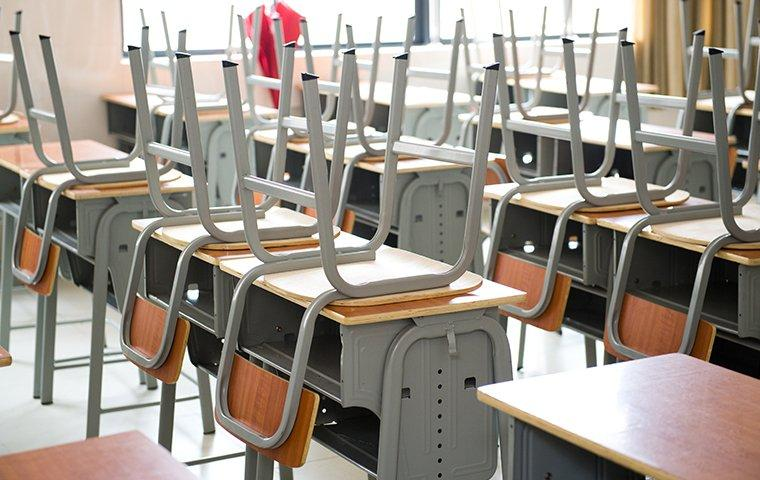 an empty classroom prepared for sanitation