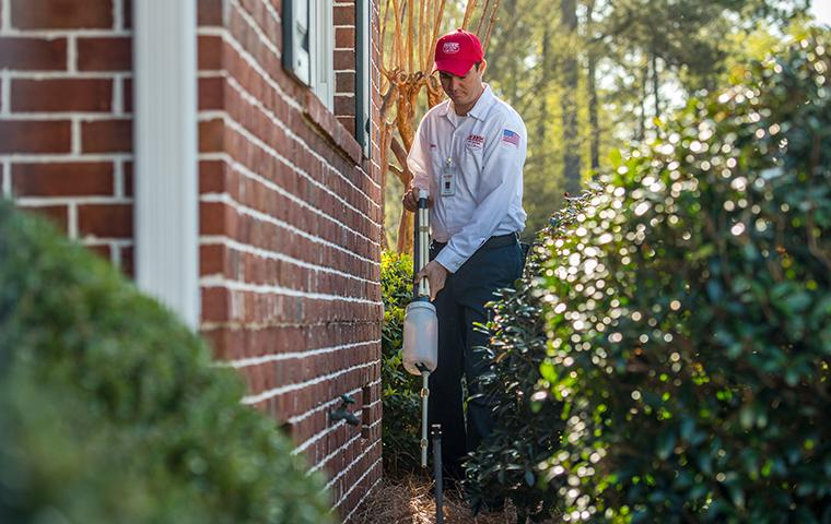 aiken tech treating for pests outside a house in south carolina