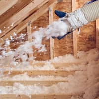 attic being filled with spray insulation