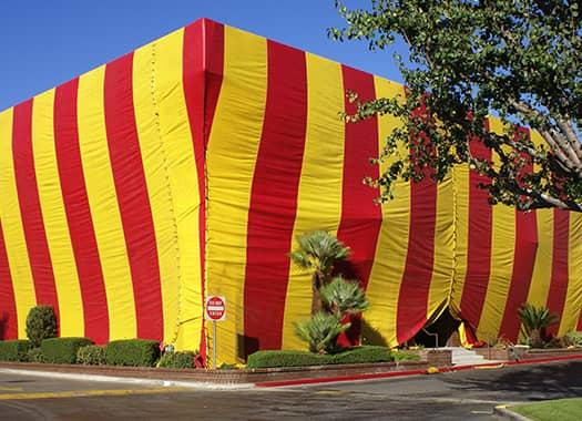 red and yellow striped fumigation tent