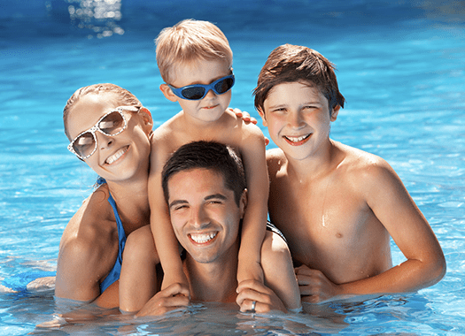 family swimming on summer vacation