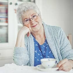senior citizen at kitchen table