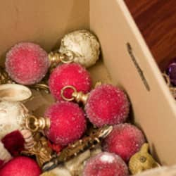 holiday decorations in a cardboard box