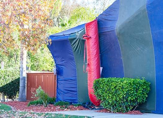 an evensville home tented and prepared for fumigation treatments this summer