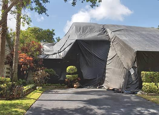 a home in evansville indiana fully tented for pantry pest fumigation on a sunny summer day