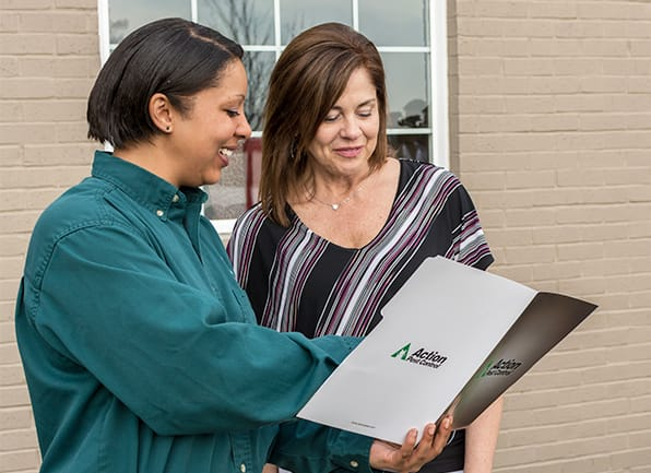 pest control technician and homeowner with action pest folder in stanford, ky