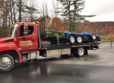 Collins Enterprises flatbed tow truck