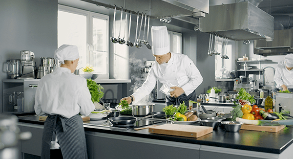 people cooking in commercial kitchen