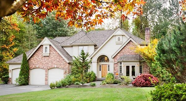 a beautiful brick home well landscaped in new england because it is fully protected against the many pests fall season bring along