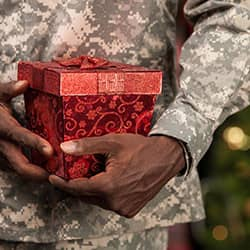 military service member holding present