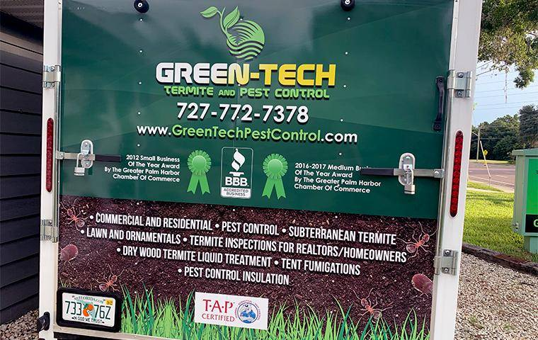 green tech and termite promo sign